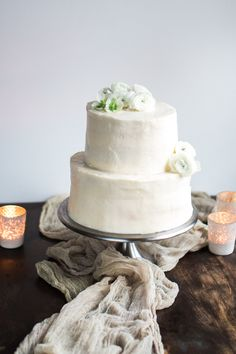 LEMONGRASS AND GINGER WEDDING CAKE    The lemongrass and ginger wedding cake has a sea buckthorn mousse between the layers and it's frosted with a white chocolate buttercream. Simple and beautiful styling.
