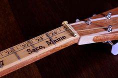 "Brick House Toro box. Mahogany Neck with maple accents. Maple bridge with rod piezo pickup. Vintage yardstick fret board. 23.5"" fret scale. Tuned G-B-D"