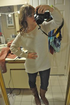Fall-ish without jacket and scarf: white baggy sweater, blue jeans, tan/brown boots.