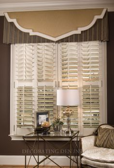 Room designed by Tracy Pulsipher Banded shapes layered valance .