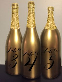 Table Number Wine Bottle Gold Glitter Wedding by GetHappyDesign