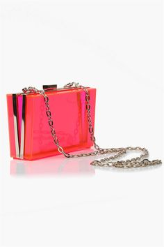 Clear Thoughts Clutch in Orange/Pink An DOPE clutch that has a see through appeal to it! This clutch has a neon orange/pink tint to it. Pair with a black and white dress for a great pop of color. Has single button for closure and comes with attachable chain for cross body wear.
