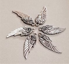 C-115; Three Sets of Antiqued Silver Wings Accented With a Rose and Leaves -6 Charms in Total Color Of The Day, Silver Wings, Pretty Roses, Upcycled Crafts, Craft Items, Beautiful Earrings, Pearl White, Antique Silver, Embellishments