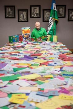 Awana Co-Founder Art Rorheim pictured with all the encouragement cards clubbers sent him when he was recovering from an illness.