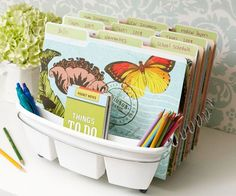 Need an easy system for organizing mail and paper work? Create a swift filing center that's as easy to maintain as it is to create. Start with a dish drainer and outfit the slots with pretty file folders. Use the utensil holders to house pens and other organization supplies. A clearly labeled, out-in-the-open filing system like this one is a simple way to keep track of daily incoming papers. You don't even have to open a drawer or a lid -- just tuck in the papers. And the portability of the…