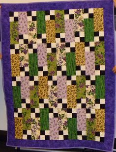 The black & white four patches make this simple strip quilt pop!