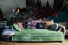 Dark and stormy wallpaper give this Anthology space and brooding, bohemian vibe.