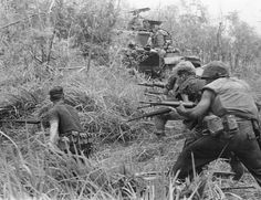 U.S. Marines direct a concentration of fire at the enemy Vietnam 8 May 1968