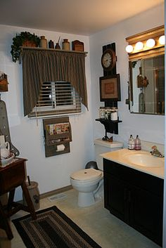 ideas for a primitive look bathroom & shelf over the window is great& Primitive Country Bathrooms, Primitive Bathroom Decor, Country Baths, Primitive Bedroom, Primitive Homes, Prim Decor, Primitive Kitchen, Primitive Furniture, Rustic Bathrooms