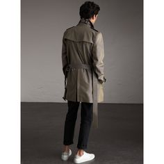A cotton gabardine trench coat featuring signature details, including epaulettes and a belted waist. The coat's weatherproof fabric, invented by our founder Thomas Burberry in 1879, is woven in Yorkshire, England. Cut in our Kensington modern fit, it is a timeless style with a tapered waist – make yours work over a suit.