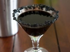 Black Widow Martini (1 1/2 oz black rum 3/4 oz crème de cacao 1 cup ice Black food color 1 Tbs brown sugar)