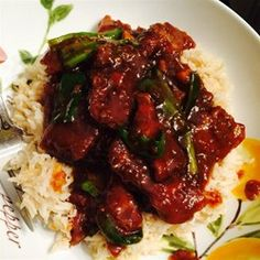 "Mongolian Beef and Spring Onions | ""A soy-based Chinese-style beef dish. Best served over soft rice noodles or rice."""