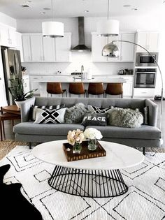 Living room inspo - monochromatic and neutrals with a mid-century modern meets updated-boho feel ❤️ Geometric black and white rugs, cowhide, jute, fur: mixing patterns and textures to create excitement even when keep the palette super simple. Home Living Room, Apartment Living, Living Room Designs, Living Room Decor, Living Area, Living Room Modern, Living Room Inspiration, Home Decor Inspiration, Ideas Hogar