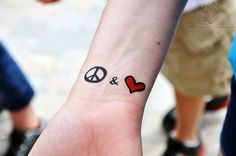 asian peace tattoo | Red heart And Peace Sign Tattoo