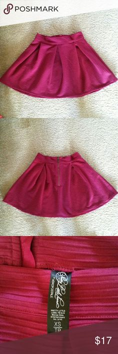 Pretty Little Liars Skirt Magenta skirt by Pretty Little Liars, only worn 2 times! There is a zipper on the back which makes it easier to put on. This skirt is a magenta color. Pretty Little Liars Skirts