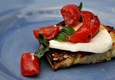 Grilled Crostini w/ Garlic marinated Tomatoes