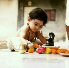 A Baby doing PoojaShiv mera mandir shiv meri pooja .