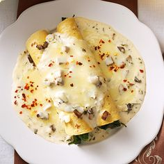 Spinach Mushroom Enchiladas Recipe -Lime, cilantro and Jack cheese lend Mexican flavors to this veggie-filled version of a real crowd-pleaser. —Evangeline Bradford, Erlanger, Kentucky