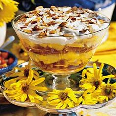 Georgia Peach Trifle  1 (3 1/2-ounce) package instant vanilla pudding mix  2 cups milk $  6 large fresh peaches, peeled and sliced  3 tablespoons granulated sugar  1/2 (20-ounce) package pound cake  1/3 cup bourbon  1 cup whipping cream  2 tablespoons powdered sugar  1/2 cup sliced almonds, toasted