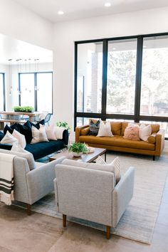 modern meets traditional living room with leather sofa and open floor plan Influencer: Kailee Wright Designer: Ashley Cooper Photographer: Aubrey Taiese Home Living Room, Interior Design Living Room, Living Room Designs, Living Room Decor, Interior Decorating, Apartment Living, Decorating Ideas, Blue Couch Living Room, Modern Living Room Chairs