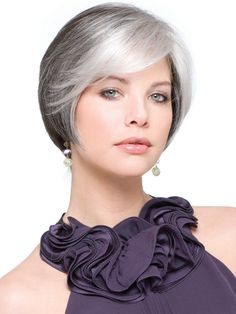 Grey White Hair looking so sophisticated and natural is actually a wig. I included for those of you who may need one to see how real they appear.  I like the white bang in the front and the smoothness of the whole top and sides.  Very lovely.