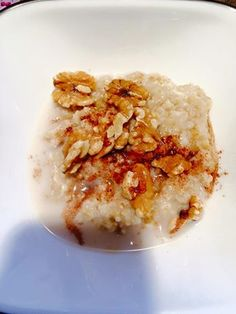 Steel cut oats, splash of almond milk, walnuts and drizzle of maple syrup.
