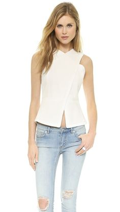Such a fun BCBGMAXARIA top with cut outs in the back!