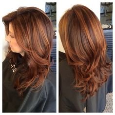 """Heavy layered long haircut. Deep copper red base with a vibrant highlight... styled with 4"""", 3"""" and 2.5"""" round brushes and shine spray. www.karakcole.com"""