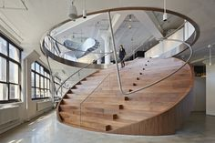 """Advertising agency Wieden+Kennedy enlisted WORKac to redesign its three-storey office in Manhattan, New York. Making great use of the enormous urban space, the modern design aligns with the creative environment of the powerhouse ad agency. Standout structures include two circular staircases that connect the in-house library to the rest of the office. In an effort to blend functionality with design, the larger staircase located at the lower levels, aptly dubbed """"Coin Stair,"""" doubles up as a…"""