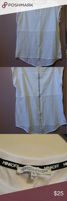 Rebecca Minkoff white tank RM tank with reflective stop down the back, more sites for working out. Fold up sleeve, high low style, bottom of tank has repeated words that make up design for a slightly see thru section. Worn once. Rebecca Minkoff Tops