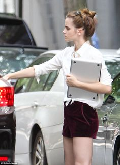Leggy lady: Emma Watson was spotted parading her pins in tiny maroon velvet shorts while getting into a black SUV in Manhattan Saturday
