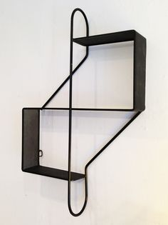 Mathieu Matégot; Enameled Steel 'Treble Clef' Wall-Mounted Shelves, c1950.