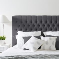 """<div> <p>Our stunning pure charcoal linen buttoned bedhead captures the style and grace of classic French decor. It features solid oak legs is beautifully crafted. The bedhead is simply placed behind your bed and your ensemble is pushed up against it. The charcoal linen also co-ordinates with all our other charcoal linen furniture including blanket boxes, bed ottomans and armchairs.</p> <p>We also have co-ordinating linen bed <span style=\""""text-decoration: underline;\""""><a…"""