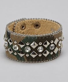 Bedecked in shimmering rhinestones and camouflaged canvas, this adjustable bracelet makes for an edgy yet chic choice.