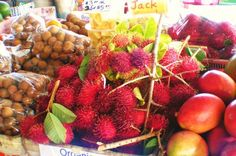 We grew and sold these---left to right:  longan, rambutan, mango---ono-licious!  Hilo Farmers Market.