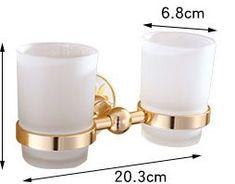 Jednoduchý dvojitý stojan s pohárikmi na zubné kefky v zlatej farbe .