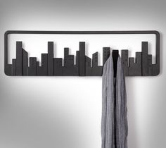 The skyline coat hook is a modern looking wall-mounted multi coat hook that resembles a night time city skyline. The skyline coat hook has 5 hooks (or buildings) that fold down and act as a hook for y...