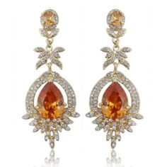 "Ever Faith 18K GP Teardrop Floral Flower Brown Swarovski Crystal Dangle Earring Pierced Ever Faith. $20.95. Each piece of the earring is fully accented with quality clear Swarovski crystals and there is a big clear teardrop rhinestone embedded on the bottom part.. Anyone who loves wearing or collecting beautiful costume jewelry would love to own or receive one of these stunning pieces.. 2.76"" by 1.18"". Austrian Crystal (one of the best quality crystals in the ..."
