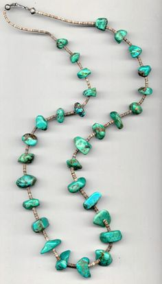 American Indian Turquoise jewelry,necklace,This Vintage Native American Jewelry Turquoise necklace was purchase thirty years ago. The 30 gorgeous large nuggets of turquoise with tiny shell spacers and silver hook form a 36 inch strand.
