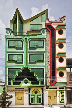 Party Halls in El Alto, Bolivia by Freddy Mamani Silvestre | Tiwanaku inspired Aymara architecture. Over the top and fabulously colourful!