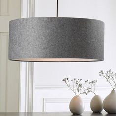 Shop short drum pendant - gray felt from west elm. Find a wide selection of furniture and decor options that will suit your tastes, including a variety of short drum pendant - gray felt. Kitchen Lighting Over Table, Dining Room Lighting, Home Lighting, Modern Lighting, Pendant Lighting Bedroom, Chandelier Pendant Lights, Living Room Pendant Lights, Drum Pendant, Drum Shade