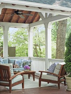 What better place to while away a lazy afternoon than on this comfy porch? An outdoor rug defines the sitting area and a ceiling fan makes sure there's always a breeze blowing. Get more tips from HGTV Magazine.