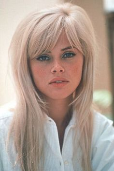 Long, side-swept bangs, layers so it isn't bushy, 60s hairstyle, but with waves preferably