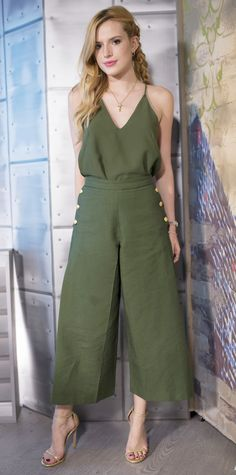 Bella Thorne pulled off olive green separates on her visit to The Lowdown with Diana Madison, tucking a loose-fit camisole into a pair of sweeping wide-leg culottes, both by Camilla and Marc. She accessorized with a delicate pendant, a stack of bracelets, and metallic sandals.