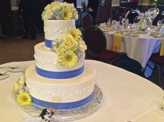 Such a cute yellow and blue wedding cake!