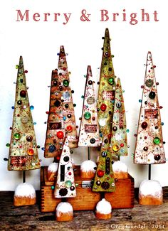 Embellished Christmas trees ~ Salvage wood, aged copper, vintage marbles, glass beads and found objects.. by Greg Guedel