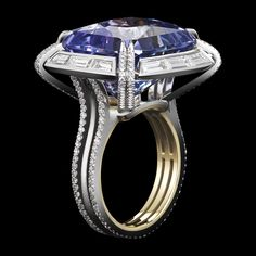 Cushion Cut Tanzanite Diamond Ring | From a unique collection of vintage cluster rings at https://www.1stdibs.com/jewelry/rings/cluster-rings/