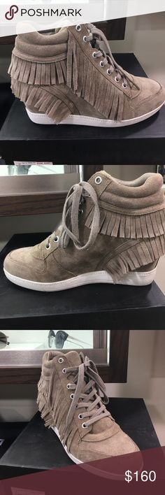 "Ash Beatnik Wedge Sneaker taupe fringed Description: Wedge sneaker  Leather Lace-up vamp Fringe trim  Leather insole and textile lining  Man-made outsole Measurements: Wedge height 2½""  Material: Leather upper; leather and textile lining; synthetic sole  Brand: Ash Ash Shoes Wedges"