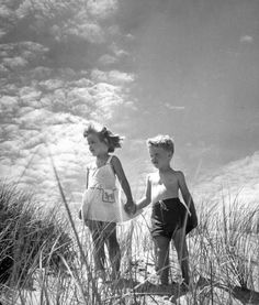 """<strong>Caption from LIFE.</strong> """"Michael Foster, 4, and his friend Marcia Perry, 5, spend the summer among the sand dunes of Cape Cod, at Contuit."""""""