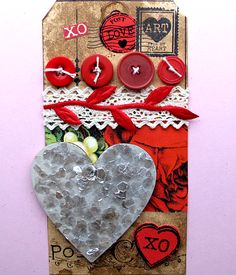 The Valentine Postcard Tag is hand made with the Red Lead Valentine post card rubber stamp, hand dyed tags, mica hearts, ribbons, and buttons.